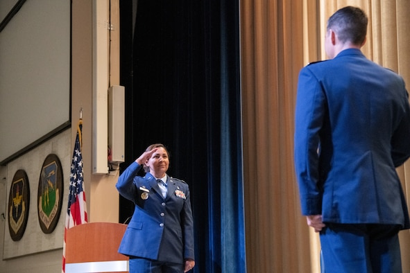 U.S. Air Force Col. Zoya Lee-Zerkel salutes Col. Patrick Carley during a change of command ceremony July 1, 2020,Maxwell Air Force Base, Alabama. Lee-Zerkel is taking over command of the 42nd Medical Group after serving as commander of the 86th Medical Group Expeditionary Medical Support stationed on Ramstein Air Base, Germany. (U.S. Air Force photo by William Birchfield)