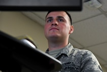 Senior Airman Tristen Flying Horse, 2nd Munitions Squadron stockpile technician, works at his computer at Barksdale Air Force Base, La., June 29, 2020.