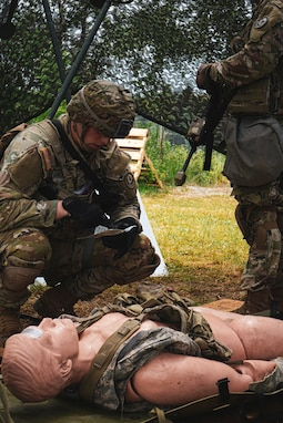 U.S. Soldier, assigned to the 2d Cavalry Regiment, reviews the tactical combat casualty care card during the Expert Infantry Badge and Expert Soldier Badge events in Vilseck, Germany, June 4, 2020. The purpose of the EIB and ESB is to recognize Soldiers who have demonstrated a mastery of critical tasks to build upon the foundation of individual proficiency. (U.S. Army photo by Sgt. LaShic Patterson)