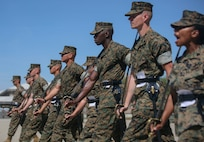Marine instructors with Drill Instructor School aboard Marine Corps Recruit Depot Parris Island instruct and mentor Drill Instructor School candidates during close order drill practice on Parris Island, S.C. April 17, 2019. Close order drill is one foundation of discipline and esprit de corps in the United States Marine Corps. Additionally, it is one of the oldest methods for developing confidence and troop leading abilities in a Marine Corps unit's subordinate leaders. (U.S. Marine Corps photo by Sgt. Dana Beesley)