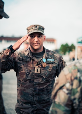 A U.S. Soldier, assigned to the 2d Cavalry Regiment, renders a salute after earning the Army Achievement Medal and Expert Infantryman Badge at the conclusion of the testing phase for the Expert Infantryman Badge and the Expert Soldier Badge in Vilseck, Germany, June 5, 2020. The purpose of EIB and ESB is to recognize Soldiers who have demonstrated a mastery of critical tasks to build upon the foundation of individual proficiency. (U.S. Army photo by Staff Sgt. Timothy Hamlin)
