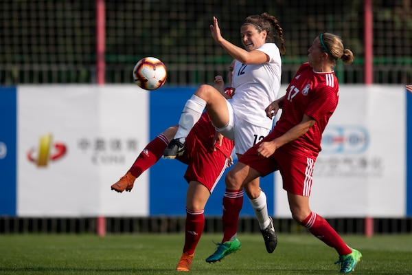 U.S. Air Force 1st Lt. Meredith Reisinger, center, of the U.S. Armed Forces Women's Soccer Team battles for a ball during a preliminary game with Germany in the 2019 CISM Military World Games in Wuhan, China Oct. 17, 2019. The Council of International Sports for the Military games open Oct. 18, 2019 and close Oct. 28, 2019. (DoD photo by EJ Hersom)