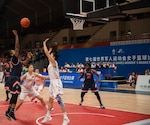 U.S. Navy Petty Officer 2nd Class Ariel Thomas, United States Armed Forces Military World Games Women's Basketball player, shoots a basket over a Chinese defender during the Conseil International du Sport Militaire Women's Basketball Competion in Wuhan China, Oct. 22, 2019. The 7th MWG will feature military athletes from around the world with an estimated participation of more than 100 nations and more than 10,000 participants. (U.S. Air Force photo by Staff Sergeant James R. Crow)