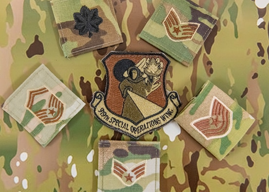 A 919th Special Operations Wing patch sits on an operational camouflage pattern backdrop at Duke Field, July 7, 2020. (U.S. Air Force photo by Senior Airman Dylan Gentile)