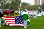 The U.S. Armed Forces Men's Soccer Team salutes the flag during the National Anthem prior to  their match against Qatar in their first preliminary round of the CISM 2019 Military World Games in Wuhan, China Oct. 16, 2019. The Council of International Sports for the Military games open Oct. 18, 2019 and close Oct. 28, 2019. (DoD photo by Mass Communication Specialist 1st Class Ian Carver/RELEASED)