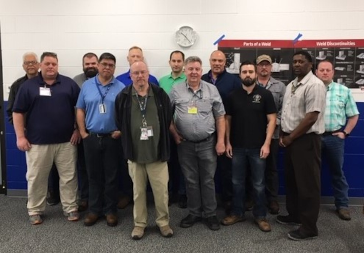 DCMA employees standing together.