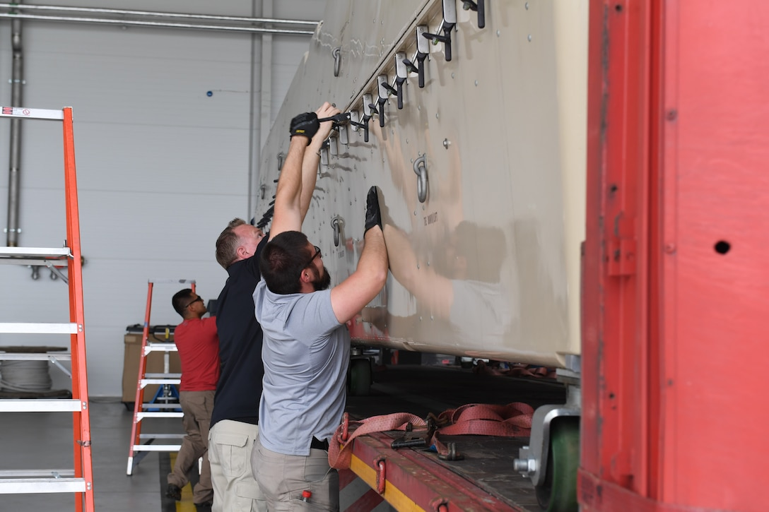 General Atomic contractors prepare to unload an MQ-9 Reaper from its container at Amari Air Base, Estonia, June 29, 2020. One of the aircraft was transported via cargo truck from Miroslawiec AB, where it was then offloaded and assembled in a hangar at Amari. (U.S. Air Force photo by Airman 1st Class Alison Stewart)