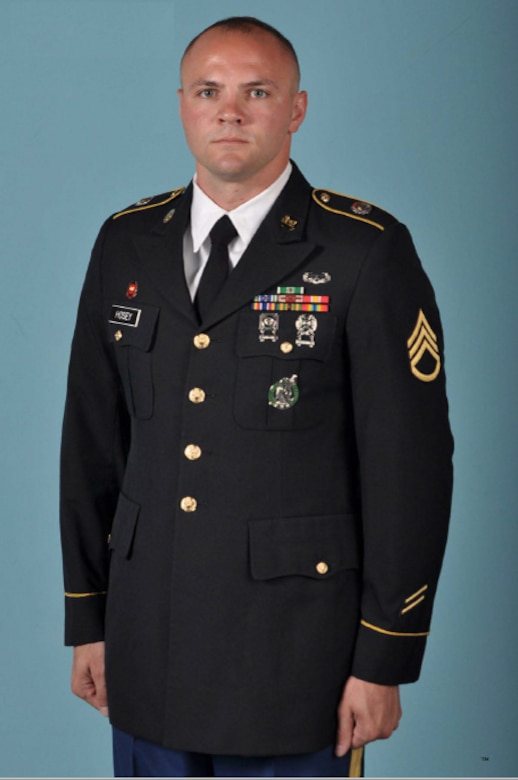 Soldier poses for official Department of the Army service photo in Army Service Uniform.