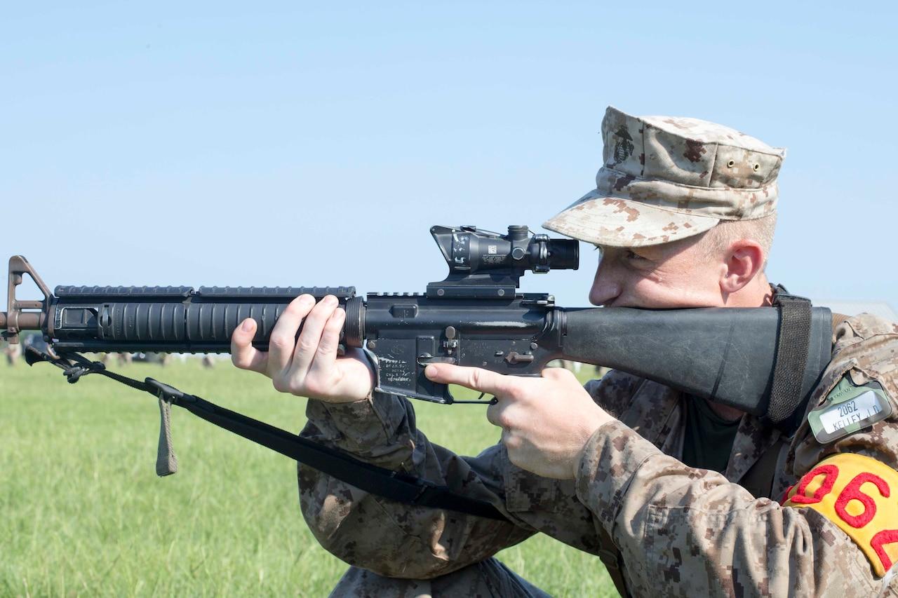 A Marine recruit prepares to fire a rifle.