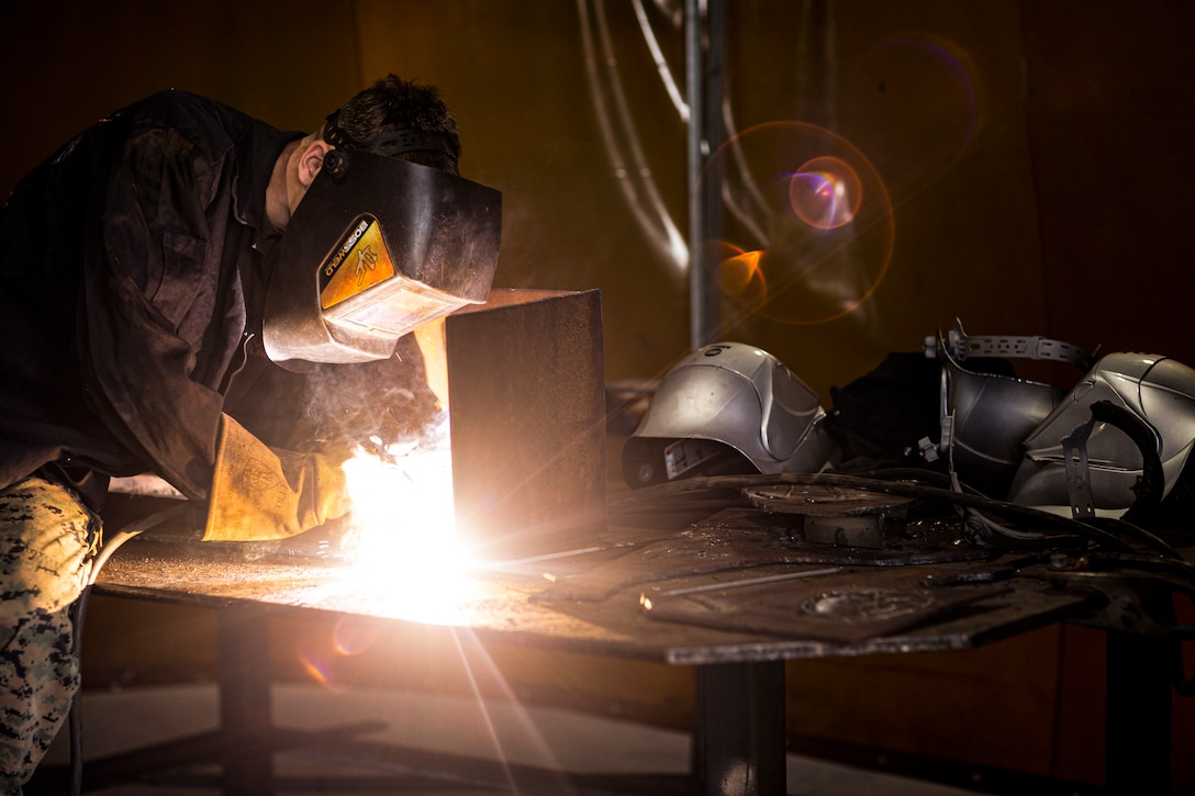 A U.S. Marine practices welding techniques at Robertson Barracks, Australia, July 2.