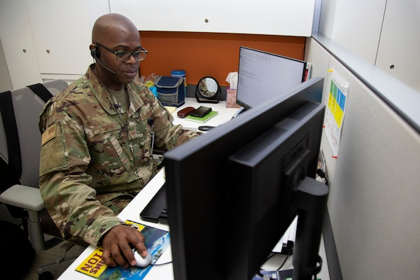 Tech. Sgt. Clayton Smith, a medical resources noncommissioned officer assigned to the Office of the Joint Surgeon at the National Guard Bureau, participates in a phone conference at the Herbert R. Temple Jr. Army National Guard Readiness Center, Arlington Hall Station, Arlington, Va., March 2, 2020. Smith came to the U.S. from Trinidad and Tobago at the age of 26 and enlisted in the Air National Guard to gain real world experience, earning U.S. citizenship along the way.