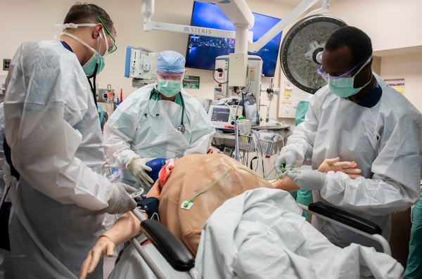 Members of the 555th Forward Surgical Team assess a simulated trauma patient during training with the Strategic Trauma Readiness Center of San Antonio