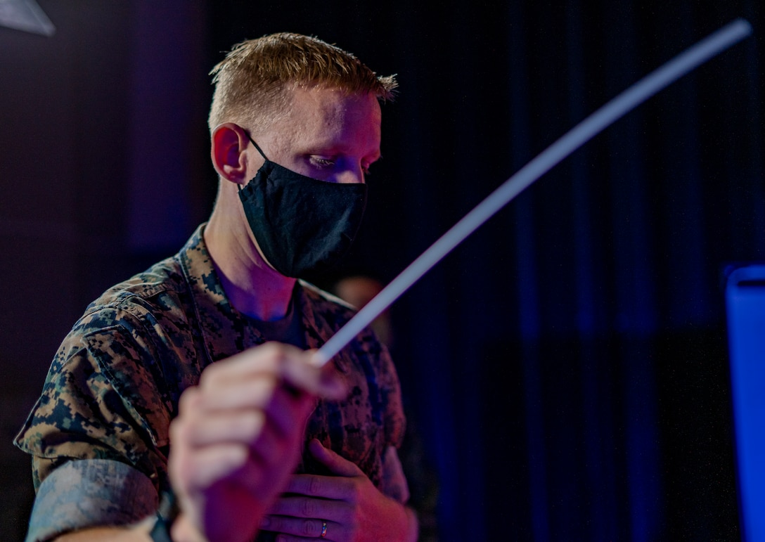 A U.S. Marine practices conducting prior to a combined performance with the Japan Ground Self-Defense Force 15th Brigade Band on June 18.