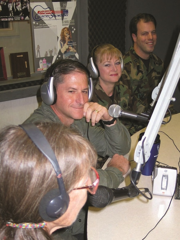 A light moment as Col. David Goldfein, 49th Fighter Wing commander, Chief Master Sgt. Marjorie McNichols, 49th FW command chief, and Capt. Joel Stark, 49th FW Public Affairs, discuss Holloman events with KRSV-FM co-host Jean Vallance, during a live radio in Alamogordo, N.M., Aug. 29, 2007. (Courtesy photo)
