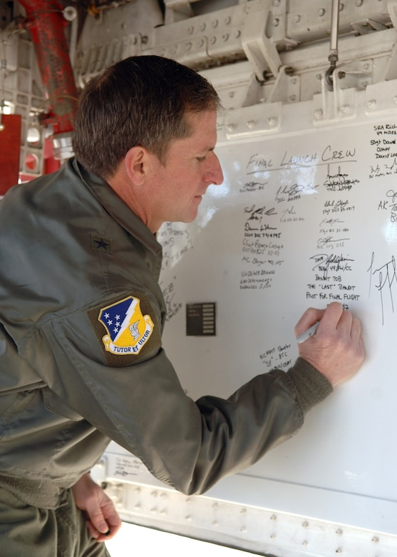 Brig. Gen. David Goldfein, 49th Fighter Wing commander, signs the bay door of one of the retiring F-117A Nighthawks, March 12, 2007, on Holloman Air Force Base, N.M. Six Nighthawks retired to Tonopah Test Range, Nevada, March 12, 2007.