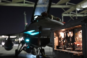 Airmen assigned to the 310th Aircraft Maintenance Unit perform maintenance on an F-16 Fighting Falcon, June 24, 2020, at Luke Air Force Base, Ariz.