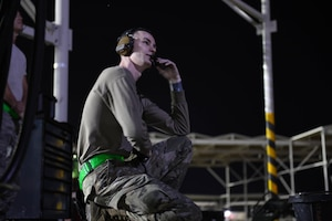 Senior Airman Robert Paul, 310th Aircraft Maintenance Unit engine technician, communicates with maintainers while performing a post-flight inspection on an F-16 Fighting Falcon, June 24, 2020, at Luke Air Force Base, Ariz.