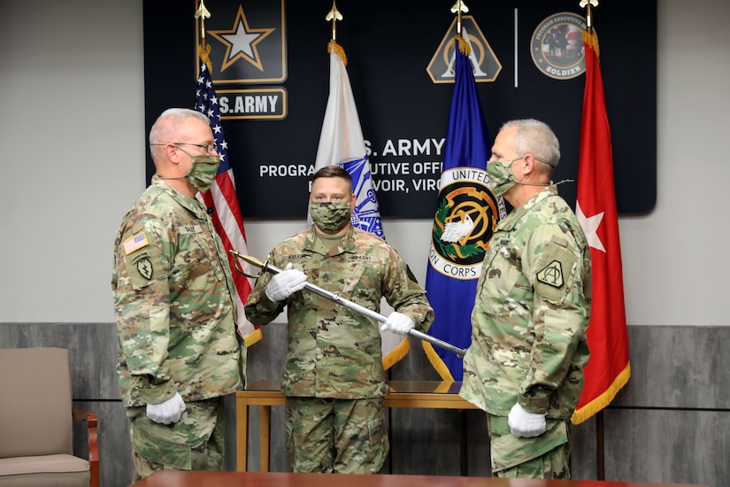 Sgt. Maj. Vern Daley is welcomed as Program Executive Office (PEO) Soldier's Sergeant Major at the Assumption of Responsibility ceremony at Fort Belvoir, Va on 19 June 2020.  Master Sgt. Marc Krugh, former Senior Enlisted Advisor to PEO Soldier, initiated the ceremony with the passing of the Noncommissioned Officer sword.