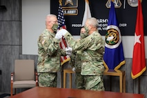 Sgt. Maj. Vern Daley accepts the Non-commissioned Officer sword from Brig. Gen. Anthony Potts, Program Executive Officer (PEO) Soldier to become the new Program Executive Office (PEO) Soldier's Sergeant Major during the Assumption of Responsibility ceremony at Fort Belvoir, Va on 19 June 2020.