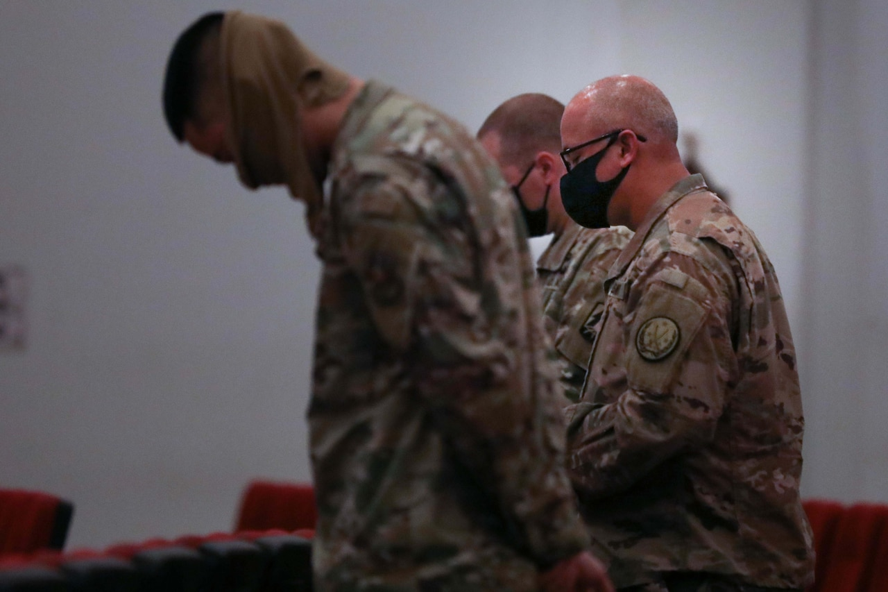 Soldiers attend worship service.