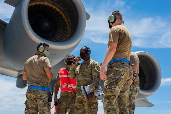 A C-17 Globemaster assigned to the 154th Wing, Hawaii Air National Guard, prepares to receive a post-flight evaluation from Airmen assigned to the 734th Air Mobility Squadron after a Joint Forcible Entry Operation (JFEO) jump at Andersen Air Force Base, Guam, June 30.