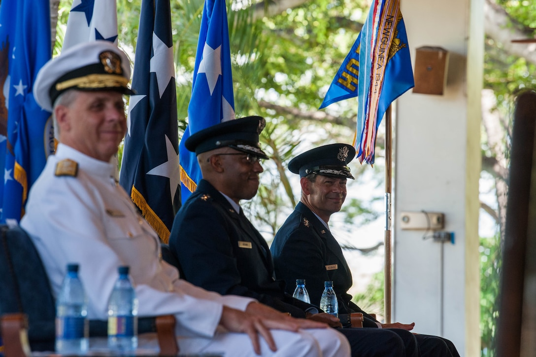 Gen. Kenneth S. Wilsbach (right), Gen. CQ Brown, Jr., and Adm. Philip Davidson, Commander of U.S. Indo-Pacific Command listen as Gen. David L. Goldfein, Chief of Staff of the Air Force, gives his remarks during the Pacific Air Forces' Change of Command Ceremony on Joint Base Pearl Harbor-Hickam, Hawaii, July 8, 2020. PACAF's area of responsibility is home to 60 percent of the world's population in 36 nations spread across 53 percent of the Earth's surface and 16 time zones, with more than 1,000 spoken languages. (U.S. Air Force photo by Staff Sgt. Hailey Haux)