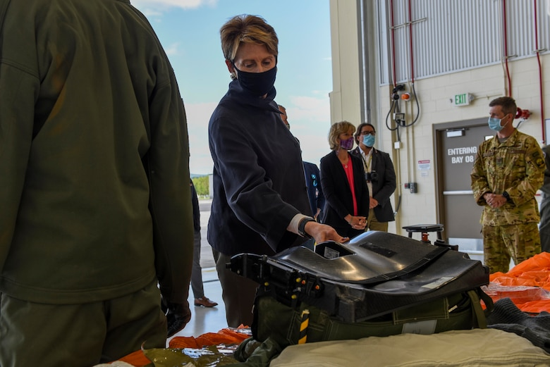 Secretary of the Air Force Barbara M. Barrett looks at the contents of an F-35A Lightning II Arctic seat kit during her visit to Eielson Air Force Base, Alaska, July 7, 2020. Barrett focused her visit on exploring arctic capabilities found only at the U.S. Air Force's northern-most fighter wing. (U.S. Air Force photo by Airman 1st Class Aaron Larue Guerrisky)