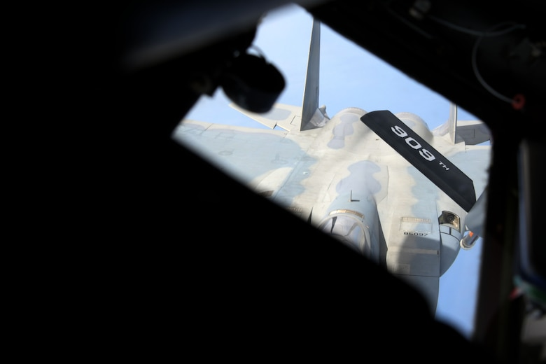 A KC-135 Stratotanker assigned to the 909th Air Refueling Squadron conducts air-to-air refueling with a 67th Fighter Squadron F-15C Eagle during a training exercise July 8, 2020, off the coast of Okinawa, Japan. The 909th ARS is the premier force for air refueling U.S. and allied aircraft during contingencies and humanitarian missions throughout the U.S. Indo-Pacific Theater. USINDOPACOM has the capacity to conduct training and exercises focused on the full spectrum of military operations, from combat to humanitarian assistance and disaster relief, anywhere throughout the Indo-Pacific region. (U.S. Air Force photo by Airman 1st Class Rebeckah Medeiros)
