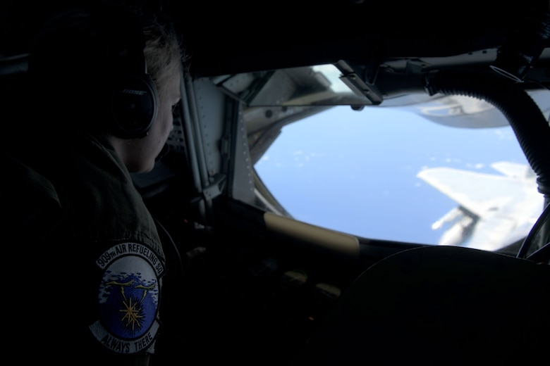 U.S. Air Force Staff Sgt. Erica Lawson, 909th Aerial Refueling Squadron boom operator, conducts air-to-air refueling with a 67th Fighter Squadron F-15C Eagle during a training exercise July 8, 2020, off the coast of Okinawa, Japan. The 909th ARS is the premier force for air refueling U.S. and allied aircraft during contingencies and humanitarian missions throughout the U.S. Indo-Pacific Theater. USINDOPACOM has the capacity to conduct training and exercises focused on the full spectrum of military operations, from combat to humanitarian assistance and disaster relief, anywhere throughout the Indo-Pacific region. (U.S. Air Force photo by Airman 1st Class Rebeckah Medeiros)