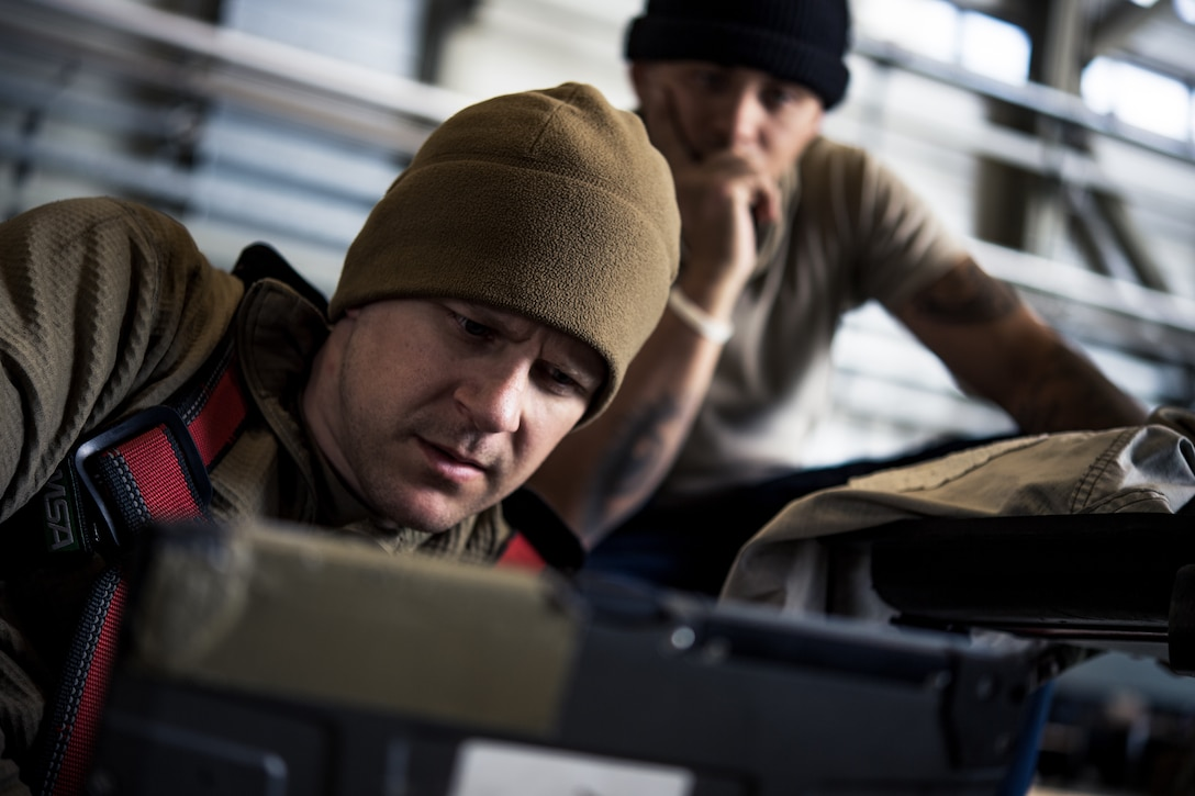 Photo of Airmen looking at computer