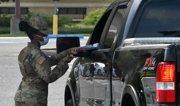 Louisiana National Guard Soldiers assist state authorities at four new COVID-19 testing sites, like this one at LSU's Alex Box Stadium, to better assist communities where there has been an increase in cases and hospitalizations, Baton Rouge, Louisiana, July 7, 2020.