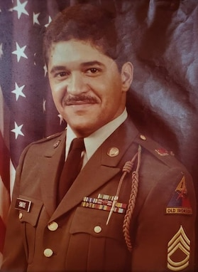Rafael Santos poses for his official photo as a sergeant first class, shortly before commissioning as a warrant officer in 1986. Santos served as a warrant officer for 15 years during his 28 years of active duty service. Now Santos uses the expertise in human resources he gained during his time in uniform as a civilian at the U.S. Army Space and Missile Defense Command. (Courtesy photo)
