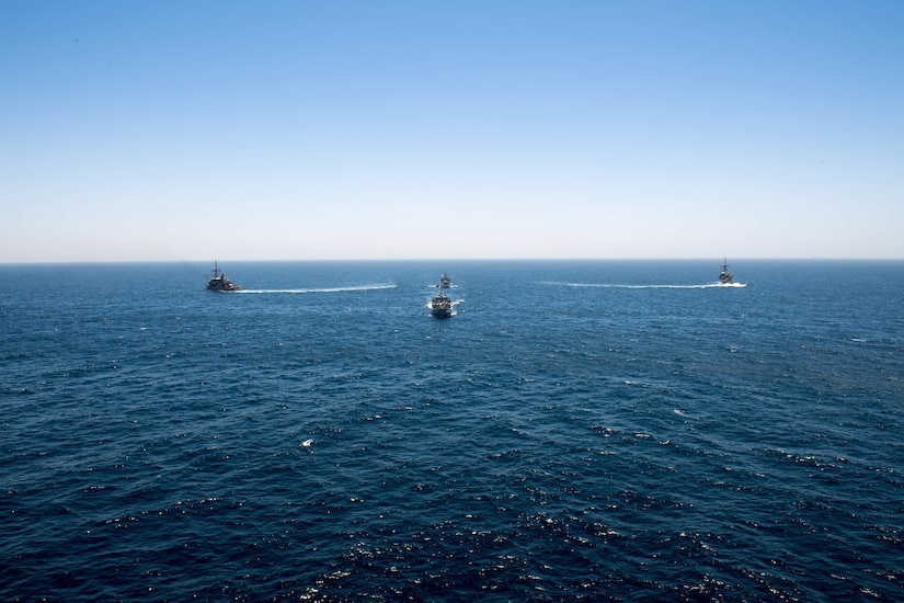 200618-N-KZ419-1010 ARABIAN GULF (June 18, 2020) Ships from Saudi Arabia, the U.K, and U.S. sail in formation during a mine countermeasures interoperability exercise in the U.S. 5th Fleet area of operations. The 5th Fleet area of operations encompasses about 2.5 million square miles of water area and includes the Arabian Gulf, Gulf of Oman, Red Sea and parts of the Indian Ocean. The expanse is comprised of 20 countries and includes three chokepoints, critical to the free flow of global commerce. (U.S. Navy photo by Mass Communication Specialist 3rd Class Dawson Roth)