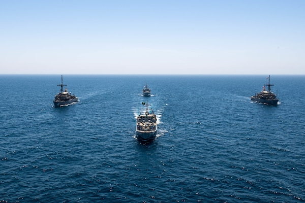 200618-N-KZ419-1007 ARABIAN GULF (June 18, 2020) Ships from Saudi Arabia, the U.K, and U.S. sail in formation during a mine countermeasures interoperability exercise in the U.S. 5th Fleet area of operations. The 5th Fleet area of operations encompasses about 2.5 million square miles of water area and includes the Arabian Gulf, Gulf of Oman, Red Sea and parts of the Indian Ocean. The expanse is comprised of 20 countries and includes three chokepoints, critical to the free flow of global commerce. (U.S. Navy photo by Mass Communication Specialist 3rd Class Dawson Roth)