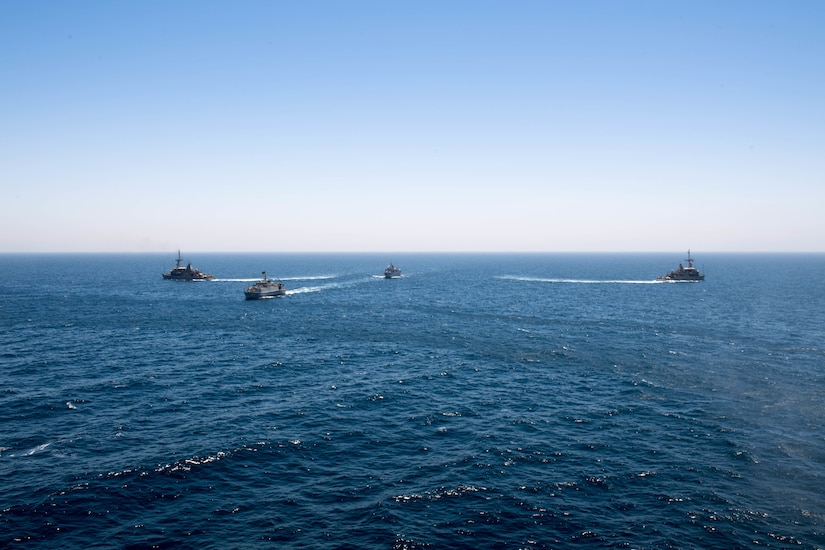 200618-N-KZ419-1008 ARABIAN GULF (June 18, 2020) Ships from Saudi Arabia, the U.K, and U.S. sail in formation during a mine countermeasures interoperability exercise in the U.S. 5th Fleet area of operations. The 5th Fleet area of operations encompasses about 2.5 million square miles of water area and includes the Arabian Gulf, Gulf of Oman, Red Sea and parts of the Indian Ocean. The expanse is comprised of 20 countries and includes three chokepoints, critical to the free flow of global commerce. (U.S. Navy photo by Mass Communication Specialist 3rd Class Dawson Roth)