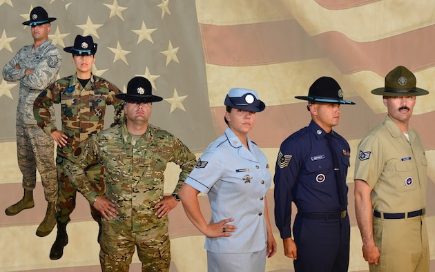 Ten Military Training Instructors from the 37th Training Wing donned legacy Air Force uniforms, dating from 1947 to the present, as they posed for a photographer at the Airman Heritage Museum on Joint Base San Antonio-Lackland June 24 to help create a new mural to decorate the walls of the Military Training Instructor Schoolhouse.