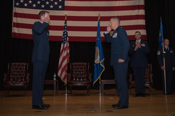 Lt. Col. Shannon Cummins, right, 22nd Communications Squadron outgoing commander, relinquishes command during a change of command ceremony July 8, 2020, at McConnell Air Force Base, Kansas. After two years at McConnell, Cummins' next duty station is Maxwell Air Force Base, Alabama, where he will be an instructor at the Air Command Staff College. (U.S. Air Force photo by Senior Airman Alexi Bosarge)