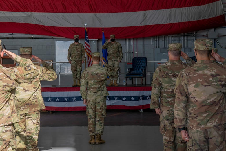 U.S. Air Force Maj. Clayton Seiler, commander of the 1st Special Operations Munitions Squadron, renders his first salute to his squadron at Hurlburt Field, Florida, July 8, 2020.