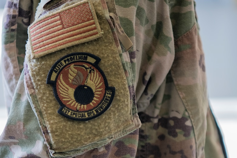 An Air Commando with the 1st Special Operations Munitions Squadron wears the new squadron patch during the 1st SOMUNS activation ceremony at Hurlburt Field, Florida, July 8, 2020.