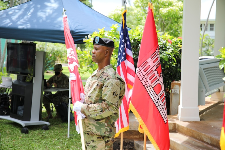 Former Pacific Ocean Division Command Sgt. Maj. Patrickson Toussaint prepares to place the division colors during a Change of Command and Responsibility Ceremony on Fort Shafter, Hawaii, July 8.