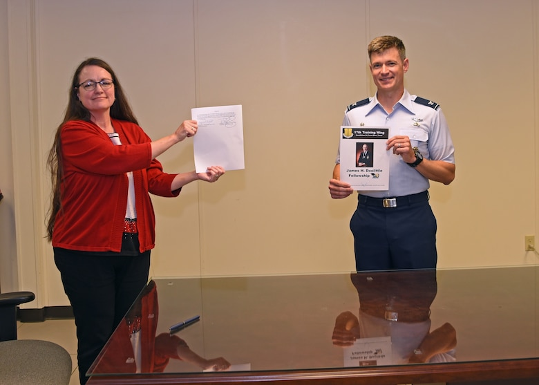 The 17th Training Group Director of Education Angelic Crawford and U.S. Air Force Col. Thomas Coakley, 17th TRG commander, presented the signed James H. Doolittle Fellowship Program memorandum of understanding at the Brandenburg Hall, on Goodfellow Air Force Base, Texas, June 16, 2020. This fellowship program supports the National Defense Strategy to build a more lethal and ready Air Force, by providing professional educators who deliver