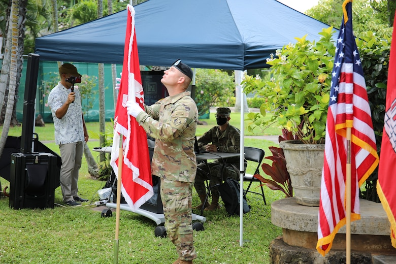 Incoming Pacific Ocean Division Command Sgt. Maj. Douglas W. Galick prepares to place the division colors during a Change of Command and Responsibility Ceremony on Fort Shafter, Hawaii, July 8.