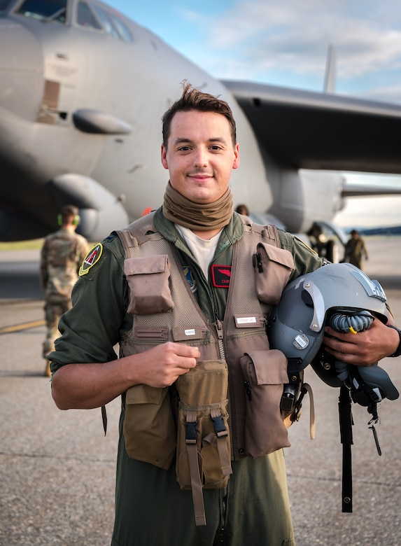 A portrait of Capt. Nathan Cooper, 96th Bomb Squadron pilot, poses for a photo in front of a B-52H Stratofortress.