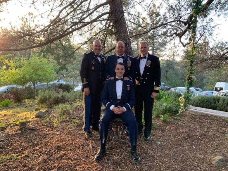 Four Cooper family members take a group photo. All four are in uniform and served at one point in their lives presenting more than 70 years of military service.