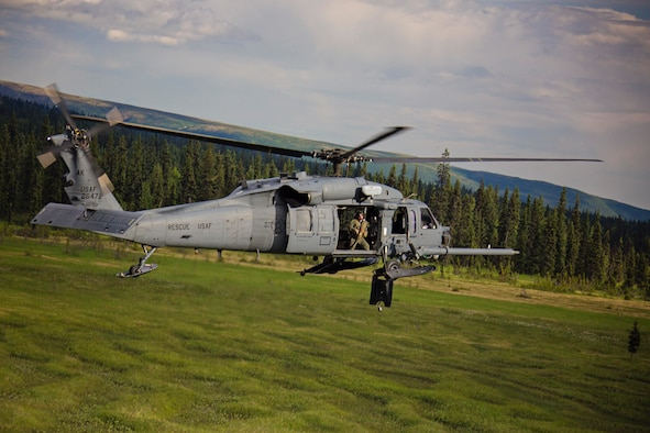 An Alaska Air National Guard HH-60 Pave Hawk, from the 210th Rescue Squadron, performs a simulated search and rescue pattern in Alaska. The 210th Rescue Squadron is part of a network of search-and-rescue organizations that save hundreds of lives in and around Alaska every year.