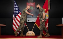 Maj. Gen. Paul J. Rock, left, outgoing commanding general of 3D Marine Expeditionary Brigade, and Brig. Gen. Kyle B. Ellison, right, incoming commanding general of 3D Marine Expeditionary Brigade, participate in a change of command ceremony at Camp Courtney, July 10, 2020. The ceremony represents the transfer of authority, responsibility, and accountability from the out-going commanding general to the incoming commanding general.