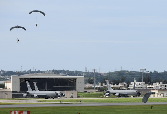 Air Force servicemembers conduct paradrop training at the Ridout drop zone July 9, 2020, on Kadena Air Base, Japan. All training on Kadena AB is conducted in accordance with bilateral agreements between the United States and the Government of Japan. Ie Jima is the primary location for overland U.S. military paradrop training in Okinawa. The bilateral agreements allow for the use of Kadena AB as an alternate location when Ie Jima is not available to meet the immediate training needs of U.S. forces.