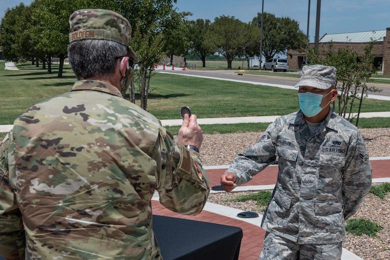 Air Force Chief of Staff Gen. David L. Goldfein bumps coins Airman 1st Class Binh Pham, a radar, airfield and weather systems Airman for the 205th Engineering and Installation Squadron, during a base tour on June 8, 2020, at Will Rogers Air National Guard Base in Oklahoma City. Pham was nominated to receive a coin from Goldfein for his exceptional contributions as a Guardsman serving at the Regional Food Bank of Oklahoma during the state's response to COVID-19. (U.S. Air National Guard photo by Senior Master Sgt. Andrew M. LaMoreaux)