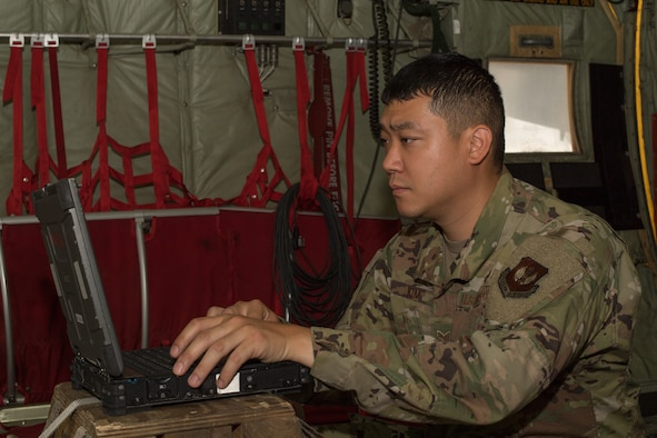 An Airman typing on a computer.