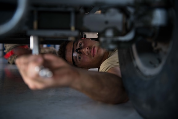 Senior Airman Nicholas Summit, 22nd Maintenance Squadron aerospace ground equipment journeyman, inspects a bolt on a self-generating nitrogen cart July 8, 2020, at McConnell Air Force Base, Kansas. AGE Airmen are responsible for maintaining flightline equipment for the 41 aircraft assigned to McConnell. (U.S. Air Force photo by Senior Airman Alexi Bosarge)